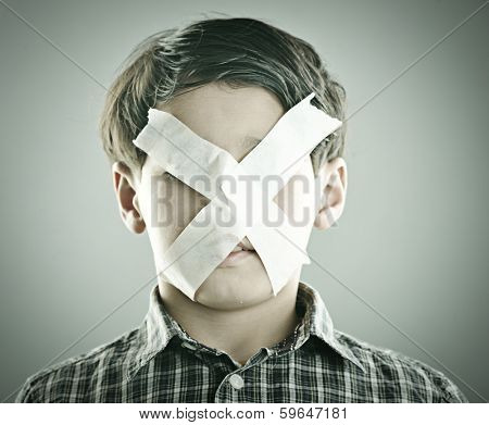 Portrait of kid with x shape on his face
