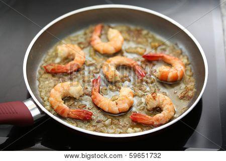fresh shrimps being fried on a pan - very shallow DOF