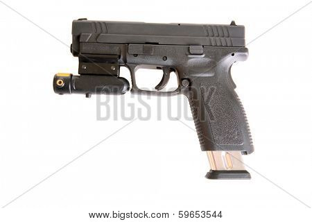 A Genuine Austrian made plastic semiautomatic Handgun with a red dot laser light attached for accuracy and intimidation when aiming at a bad guy. isolated on a white  with room for your text
