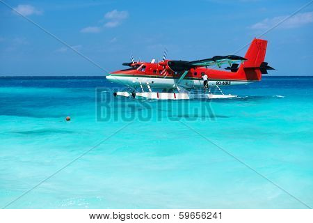 SOUTH ARI ATOLL, MALDIVES - DECEMBER 12 2013: Twin otter red seaplane at Maldives