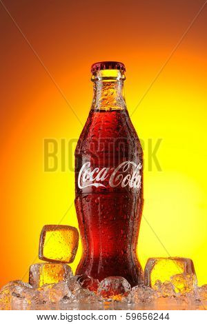 MOSCOW, RUSSIA - MAY 22, 2011: Classic  bottle Of Coca-Cola in ice studio shot.  Classic bottle of coca-cola in ice.