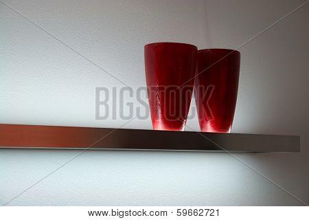 Modern Red Vases On A Shelf