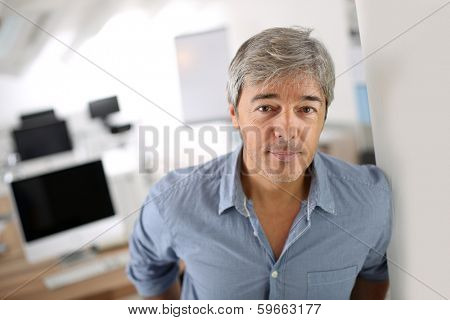 Mature businessman standing in office