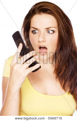 Woman Looking Shocked At Her Phone