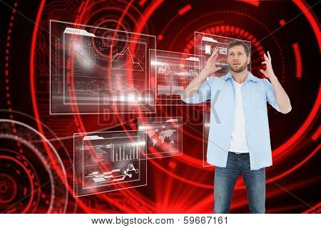 Reproachful man looking up against shiny red circles on black background