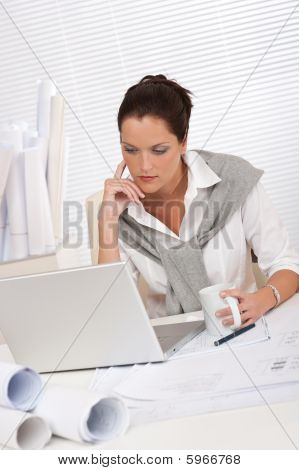 Female Architect With Laptop And Coffee Sitting