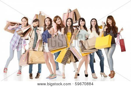 Happy Asian shopping girls on white background.