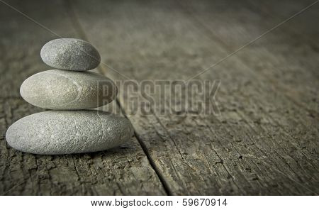 Small Stones on Wooden Background
