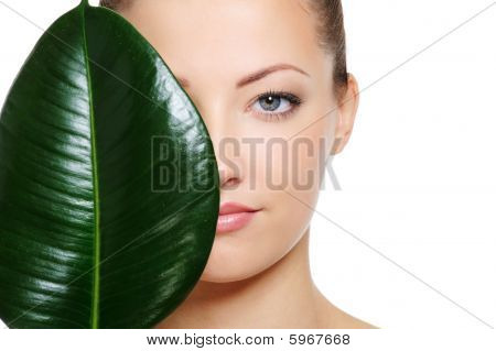 Green Leaf Shading A Half Of Beautiful Woman Face