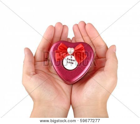 Hands holding red heart shape gift box