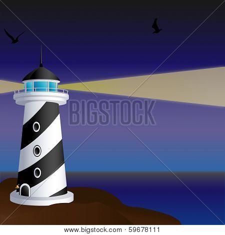 Night Lighthouse On A Rocky Shore