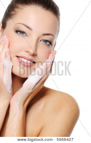 Woman Washing Her Beauty Health Face With Foam On Her Hands