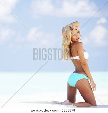 Beautiful woman in bikini on tropical beach