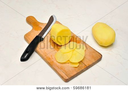 Sliced, peeled raw potatoes