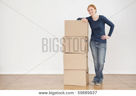 Smiling Woman With Moving Or Storage Boxes
