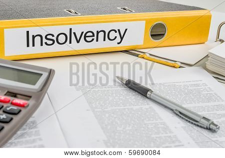 A yellow folder with the label Insolvency