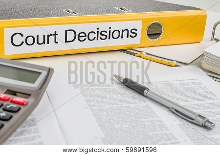 A yellow folder with the label Court Decisions