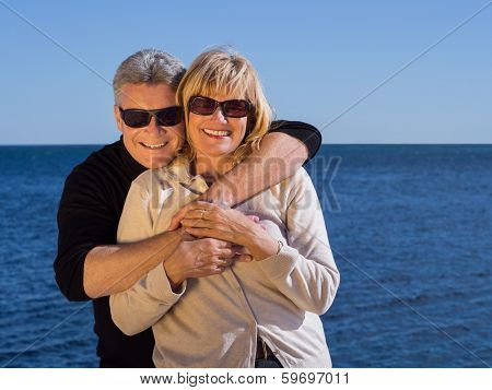 Laughing Romantic Mature Couple Enjoy A Day At The Sea