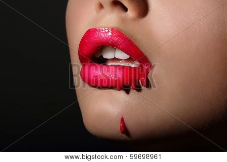 Splash. Woman's Red Lips With Dripping Lipstick. Creativity