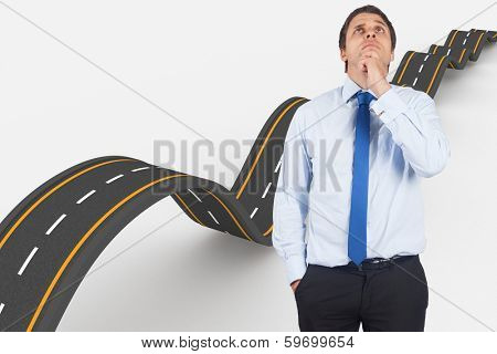 Thinking businessman touching his chin against bumpy road background