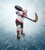 picture of hockey arena  - Aggressive hockey player shot into viewer on the ice arena - JPG