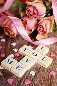 image of scrabble  - love words made of scrabble letters and dried roses for valentine on wooden table - JPG