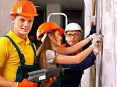 foto of millwright  - Happy group people in builder uniform indoor - JPG