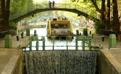 Tourist Canal Boat And Lock On The Saint-martin Canal poster