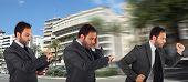 picture of running-late  - Young businessman running in office because it is late - JPG