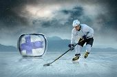 pic of ice hockey goal  - Ice hockey player at the ice - JPG