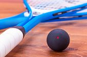 stock photo of bouncing  - Close up of a squash rackets and balls - JPG
