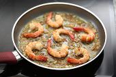 picture of fried onion  - fresh shrimps being fried on a pan  - JPG