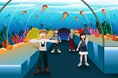 stock photo of jellyfish  - A vector illustration of kids looking at jellyfish in a big aquarium - JPG