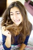 foto of split ends  - Woman holding destroyed hair with split ends - JPG