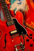 picture of fret  - Red electric guitar over textured grunge background - JPG