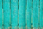 foto of slit  - Shabby blue wooden fence with wide slits
