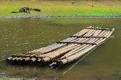 stock photo of raft  - bamboo raft on the coast river India - JPG