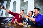 picture of selfie  - Asian party people group of young friends taking pictures or selfies with their mobile or cell phone in fancy night club - JPG