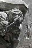 stock photo of gargoyles  - Giggling gargoyle as a decor element of the New Town Hall in Munich