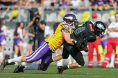 VIENNA,  AUSTRIA - APRIL 21 DL Florian Gr�?�?�?�¼nsteidl (#94 Vikings) sacks QB Jonathan Dally