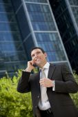 Businessman Talking On His Cell Phone In A Modern City