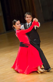 stock photo of waltzing  - Couple of kids waltzing at dance competition - JPG