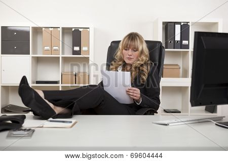 Manager Woman Relaxing At Work Reading Paper