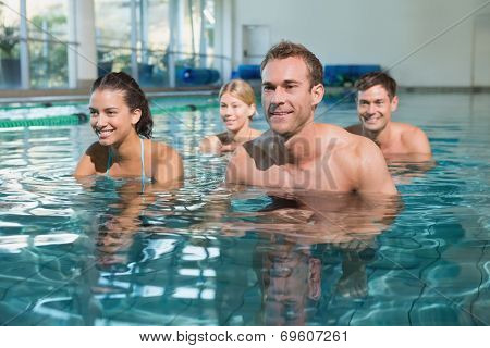 Fitness class using underwater exercise bikes in swimming pool at the leisure centre
