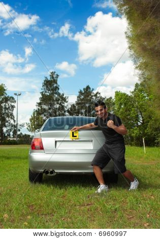 Happy Male Driver Holding Learner Licence Plates Beside Car
