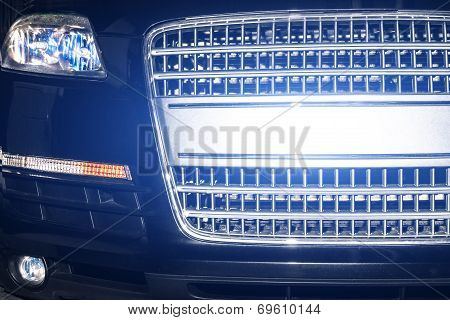 Car grill and bumper xenon reflections