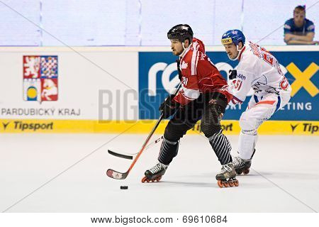 Two inline hockey players