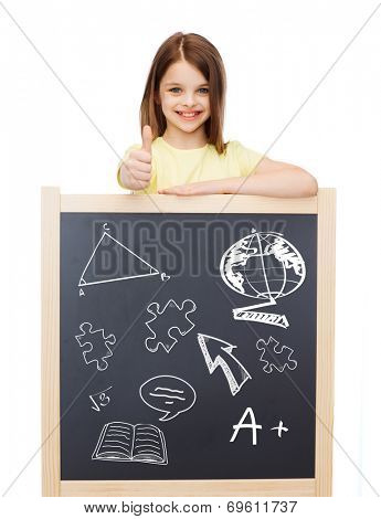 people, childhood, gesture, doodles and education concept - smiling little girl with blackboard showing thumbs up