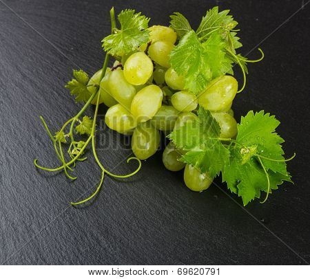 Green Grape Cluster On A Slate  Surface