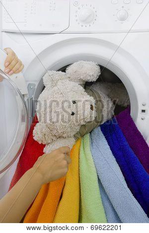 Woman Taking Toy From Washing Machine